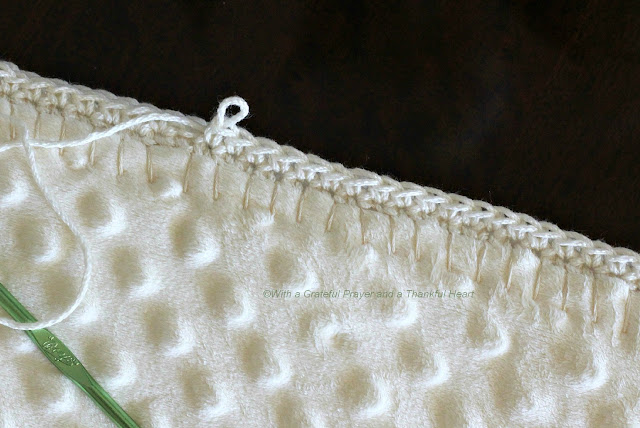 Crocheting Edges On Fleece Blankets : the blanket right-side out and began blanket-stitching around the edge ...