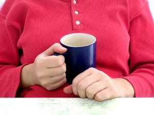 Mug of tea - A mum-to-be relaxing with a mug of tea. Stock Photo credit: debsch