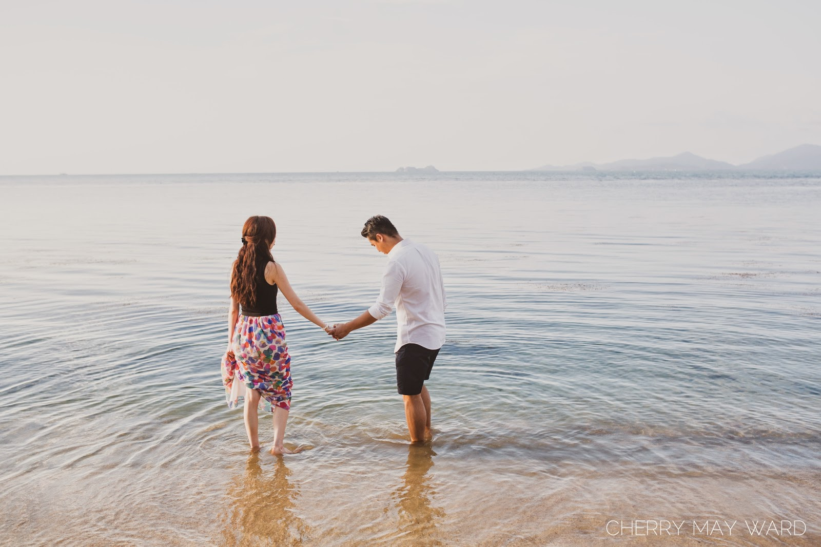 Couple's engagement session on the beach at Koh Samui, holding hands in the water enjoying the sunset, beautiful beach setting for engagement photos on Koh Samui
