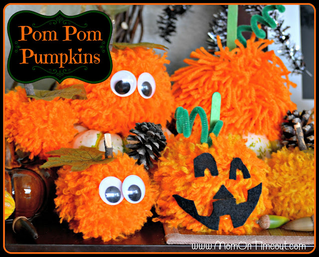 Make these Pom Pom Pumpkins with the kids this Halloween season! Super fun and SO easy too!  | MomOnTimeout.com