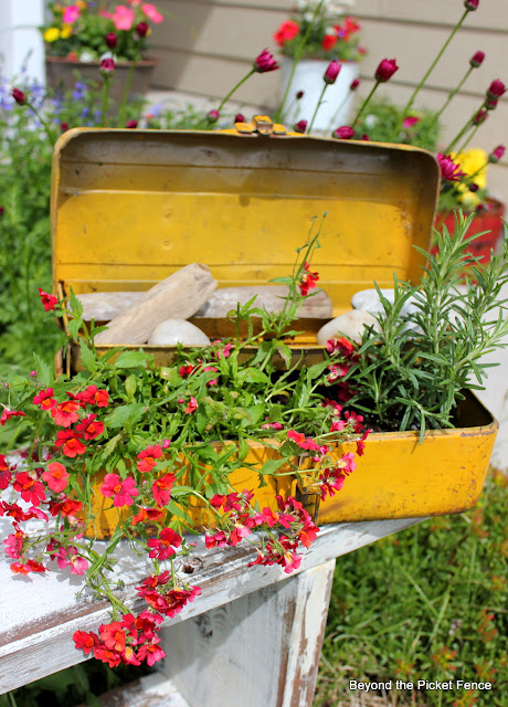 rusty toolbox, planter, repurposed, flowers, may day, http://bec4-beyondthepicketfence.blogspot.com/2012/06/my-strange-addiction.html