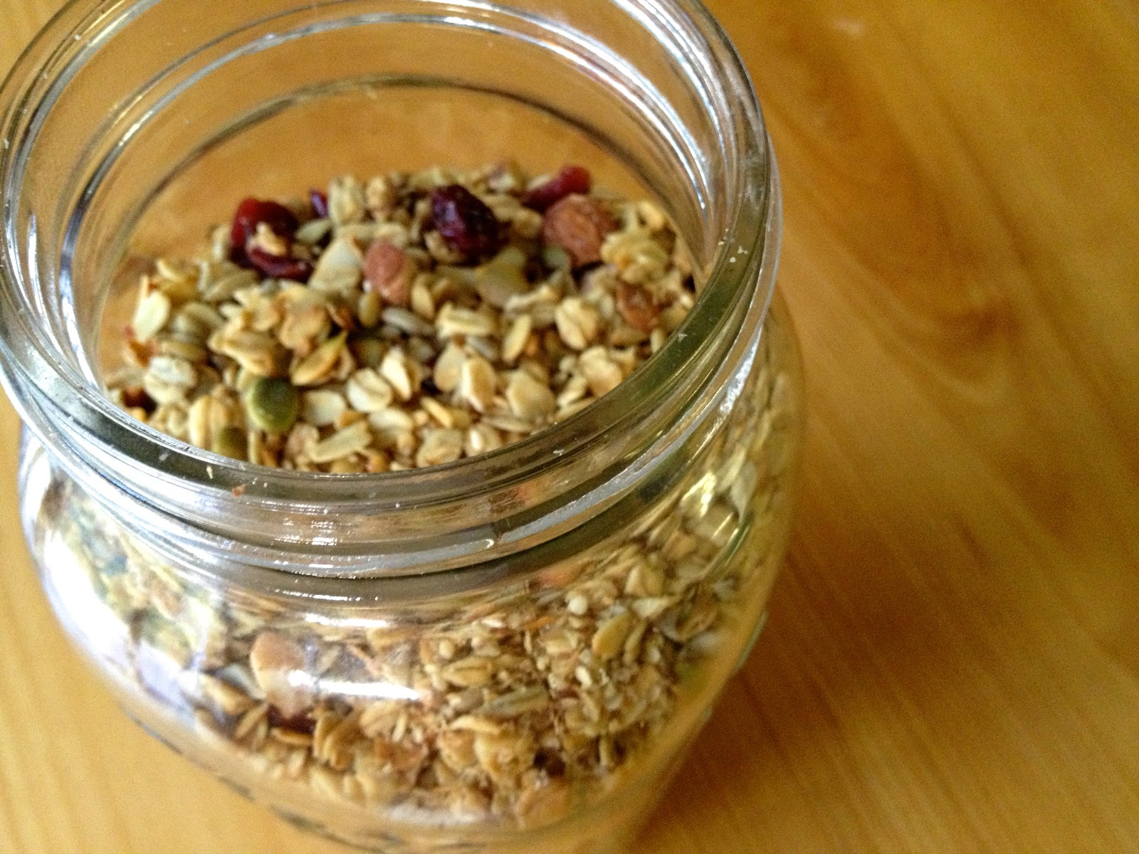 delicious homemade granola stored in an airtight mason jar