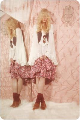 woman looking into mirror, 70's room, fashion shoot, sheepskin rug