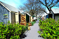 Photo showing the walkway through the artist shanties on Hyannis Harbor.
