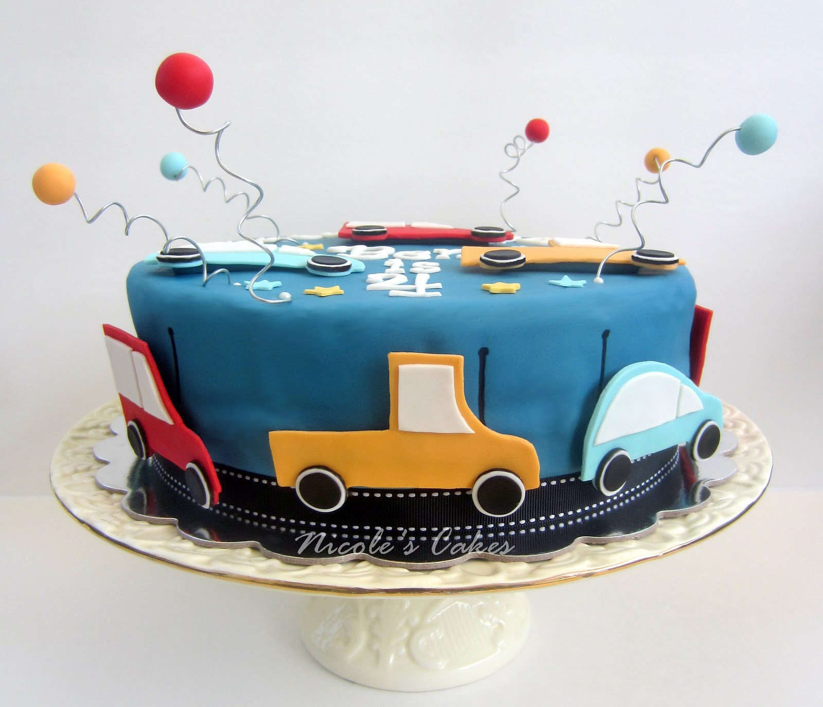 On Birthday Cakes Car themed birthday cake