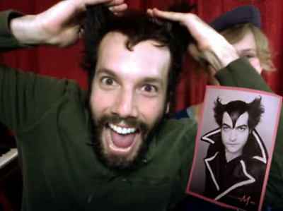 Jack Conte, copying the hair style of a French artist during one of his streamed shows, 2011.