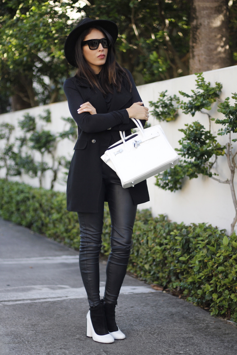 black vest and leather pants