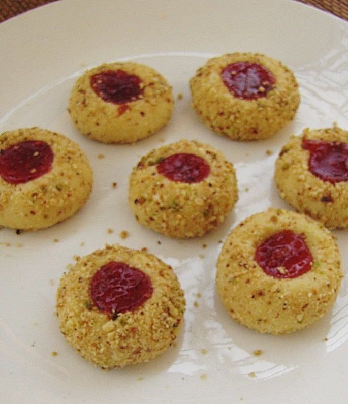 Super yummy recipes delicious eggless thumbprint jam cookies dry roast the almond pistachio cashewnut and make a rough grained powder beat the jam with the spoon until it becomes a smooth consistency and keep aside forumfinder Images
