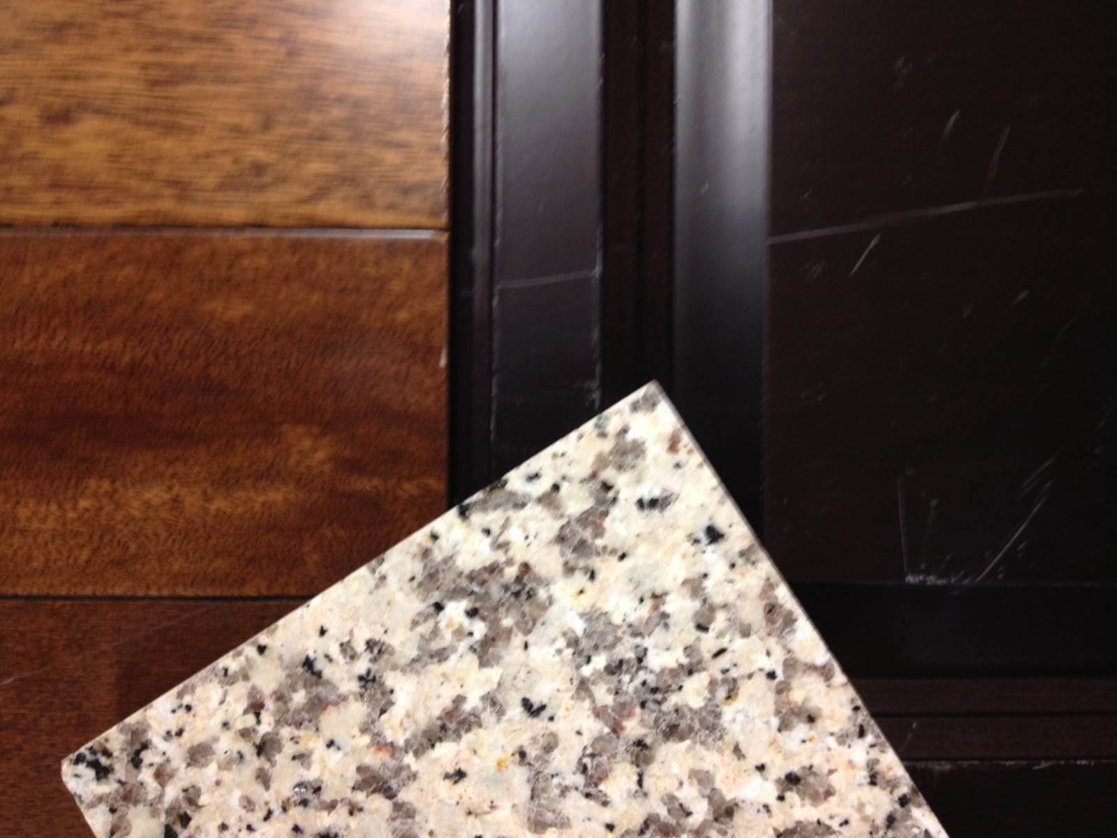 Luna Pearl Granite with Espresso Cabinets
