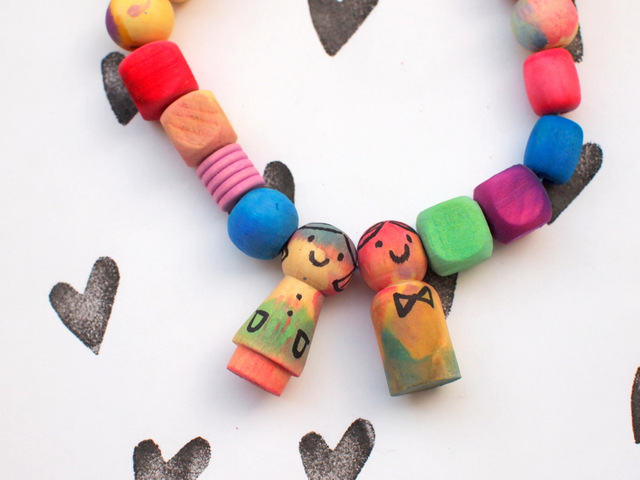 how to make colorful peg doll and wooden bead necklaces using liquid watercolors