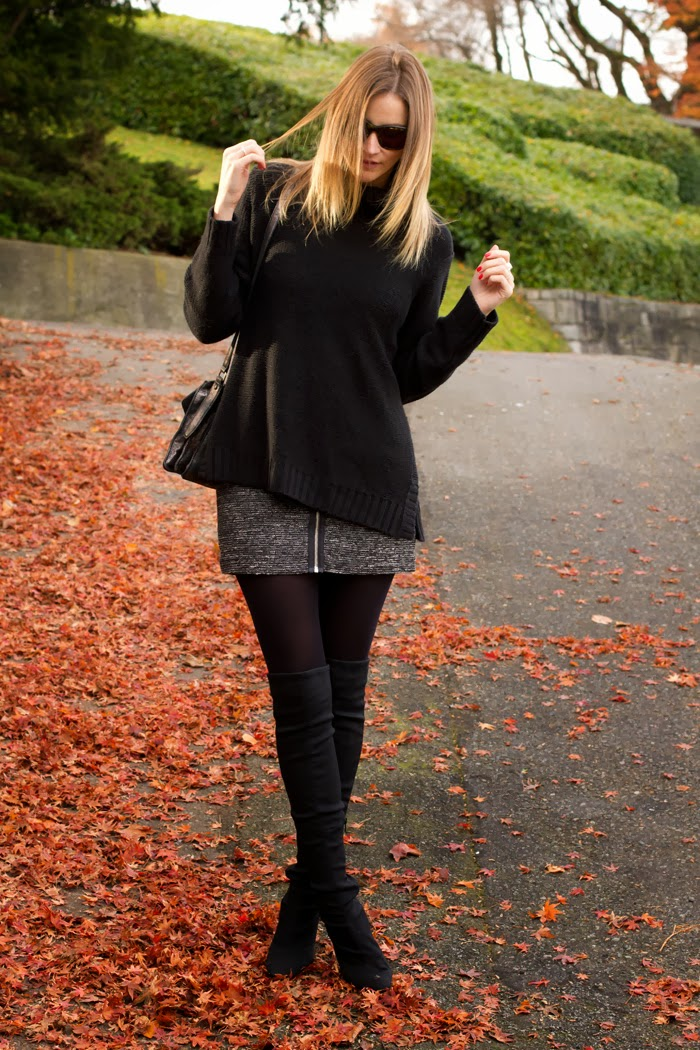 Vancouver Fashion Blogger, Alison Hutchinson, is wearing a black H&M turtleneck sweater, grey Aritzia Skirt, Black nine west over-the-knee boots, a silver botkier valentina bag and Sass & Bide sunglasses