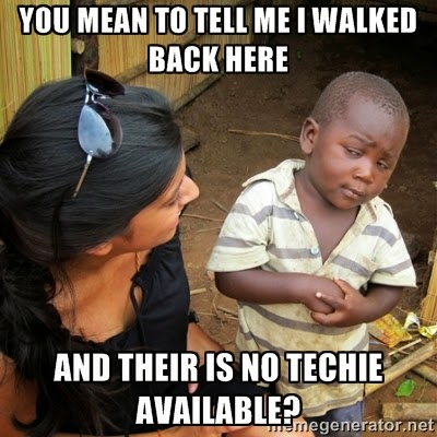 Skeptical Third World Kid out of office sign for helpdesk techs