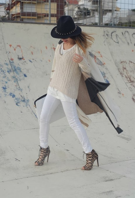 Lovely Sweater with Black Hat and White Pants. Very Stylish Shoes and Hand Bag Complete White Style