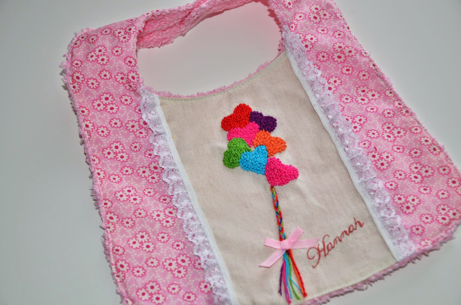 A personalised bib with French knots by MADE BY Y