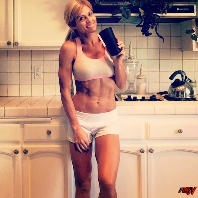 Torrie Wilson Showing Off Her Six Pack Again.