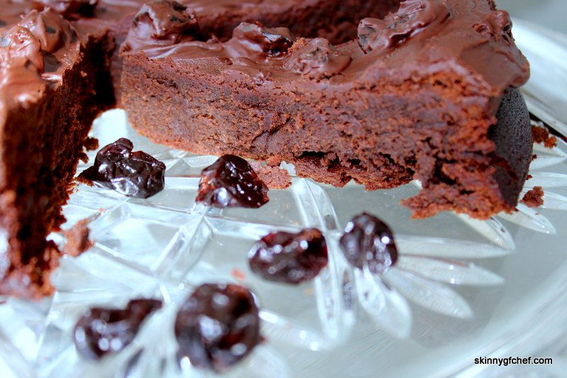 This gluten-free Flourless Dark Chocolate Cherry Cake recipe is super easy make and seriously delicious. No gluten-free flour mix needed!