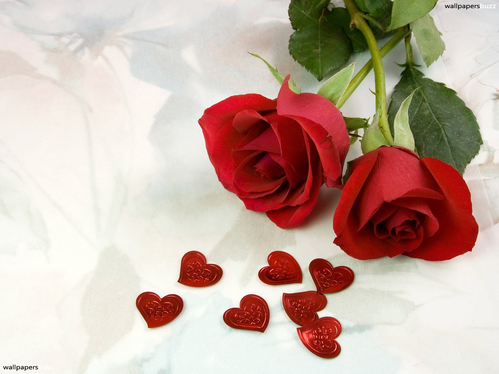 Two red roses with red hearts