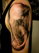 Elephant Tattoo on Hand. Big and strong, that's a glimpse of what comes to . (elephant tattoo on hand tattoosphotogallery)