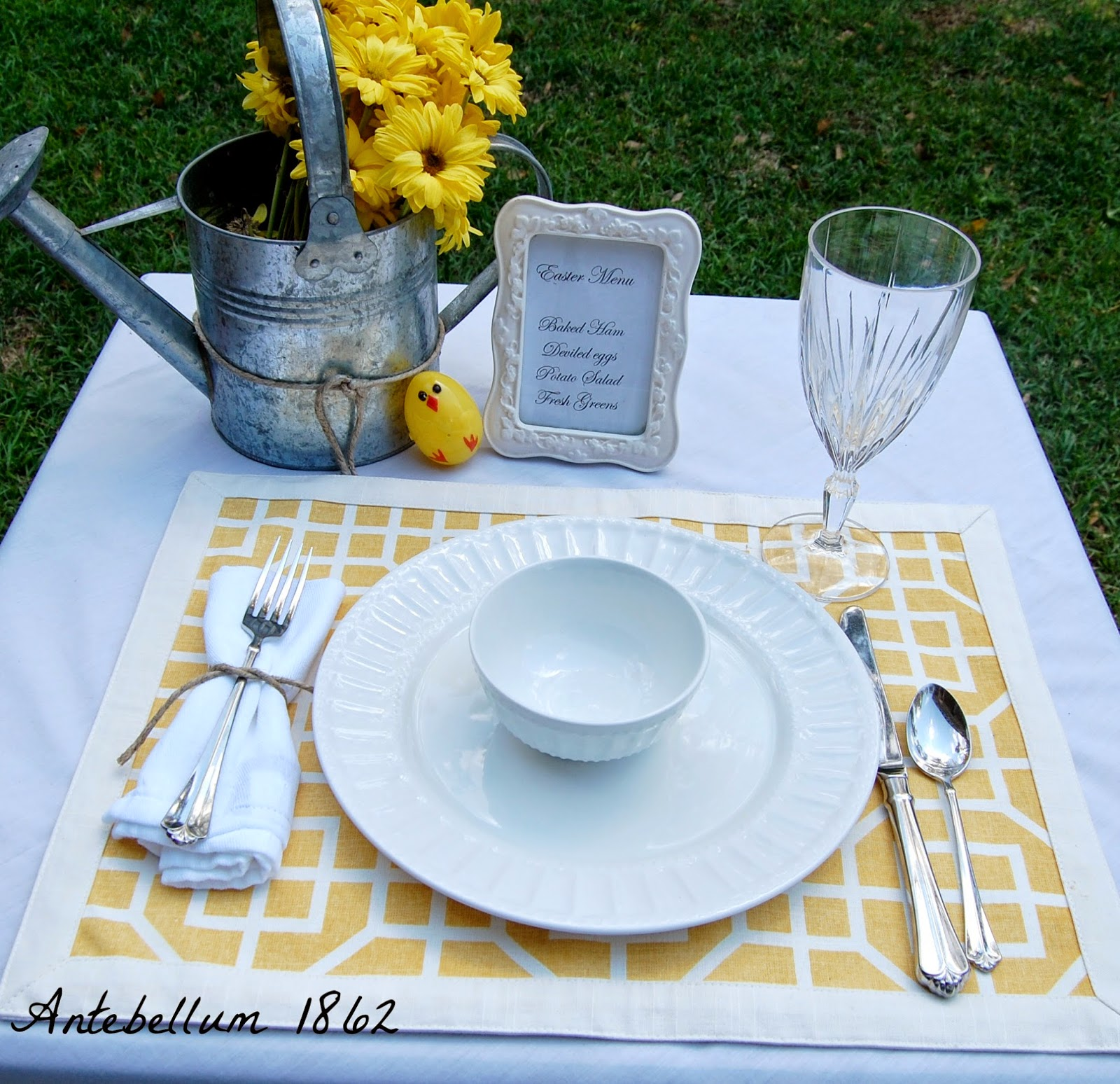 You can make your table setting less formal by having a little fun. Flowers in a watering can and plastic peep eggs make this fun especially for the kids. & Antebellum 1862: How to Create Simple Table Settings for Easter