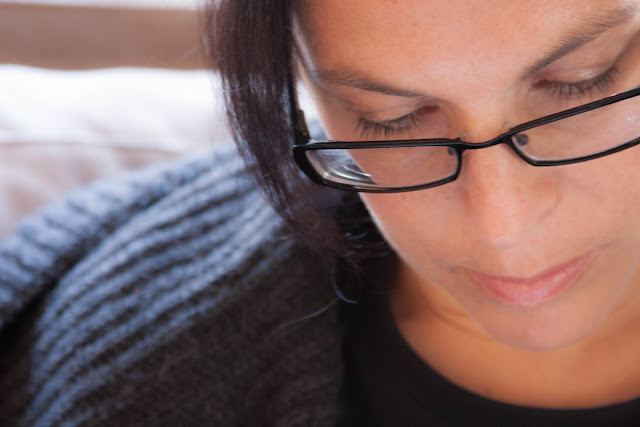 close-up of woman wearing glasses reading