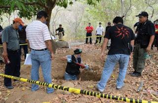 Hallan fosa clandestina con 19 cuerpos en Guerrero