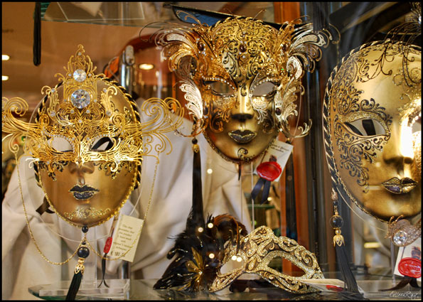 close up of shop window in Venice with golden masks
