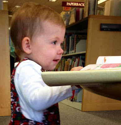 Madeline sitting at the library table.
