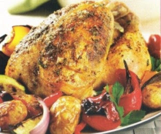 Picture of Herb-Roasted Chicken with potatoes and bell pepper