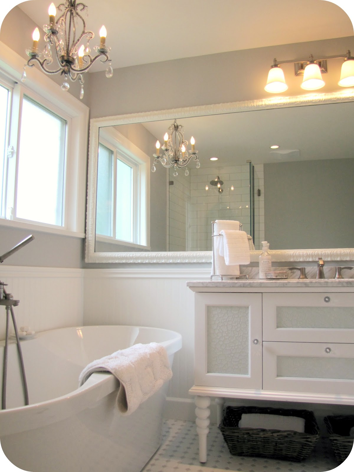 New White And Gray Bathroom With White Walls Paired With Gray Subway Tile