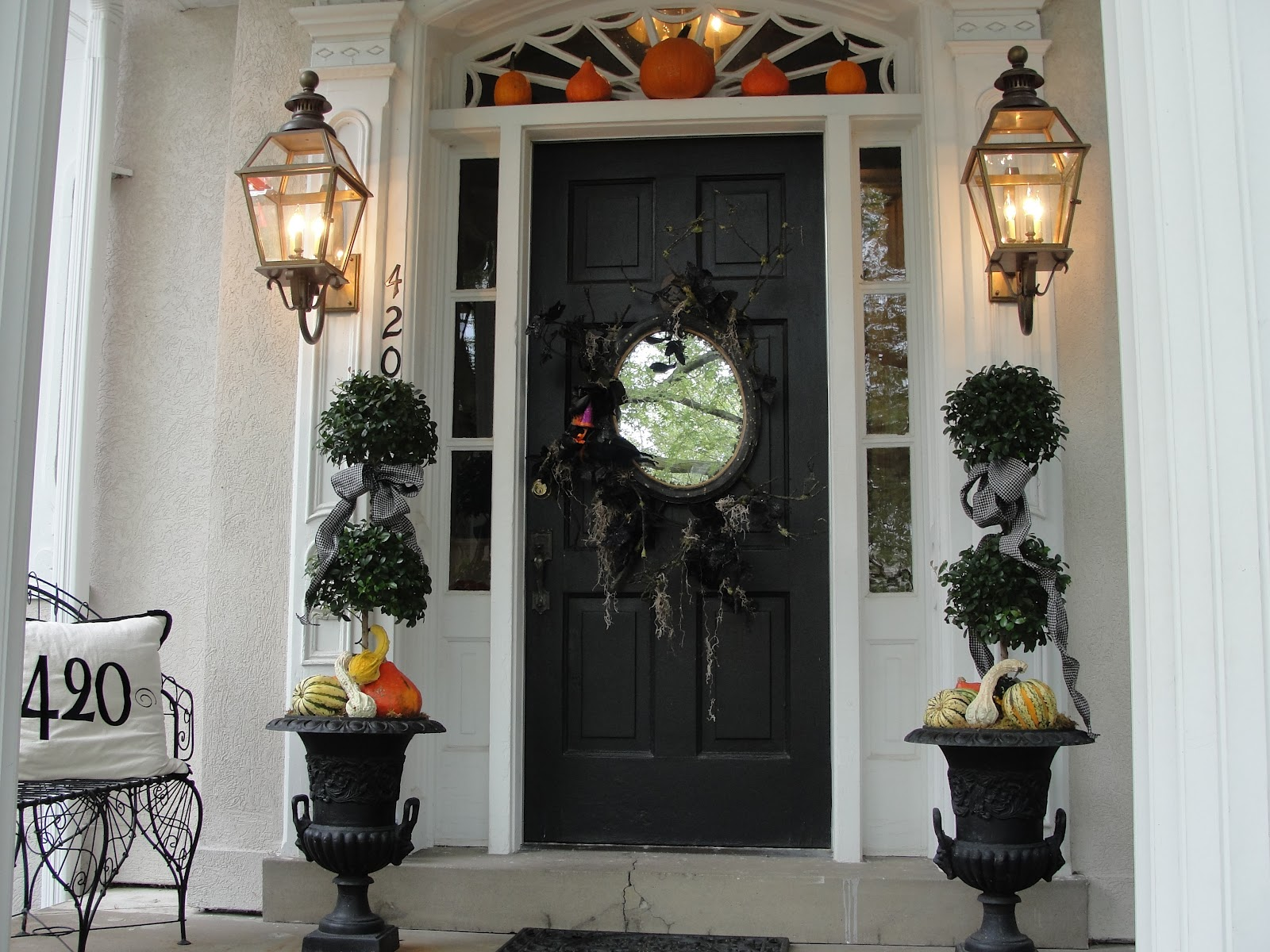 Yearning for urns the enchanted home a beautiful pair of iron urns dressed up for fall flanks this front door nell hills rubansaba