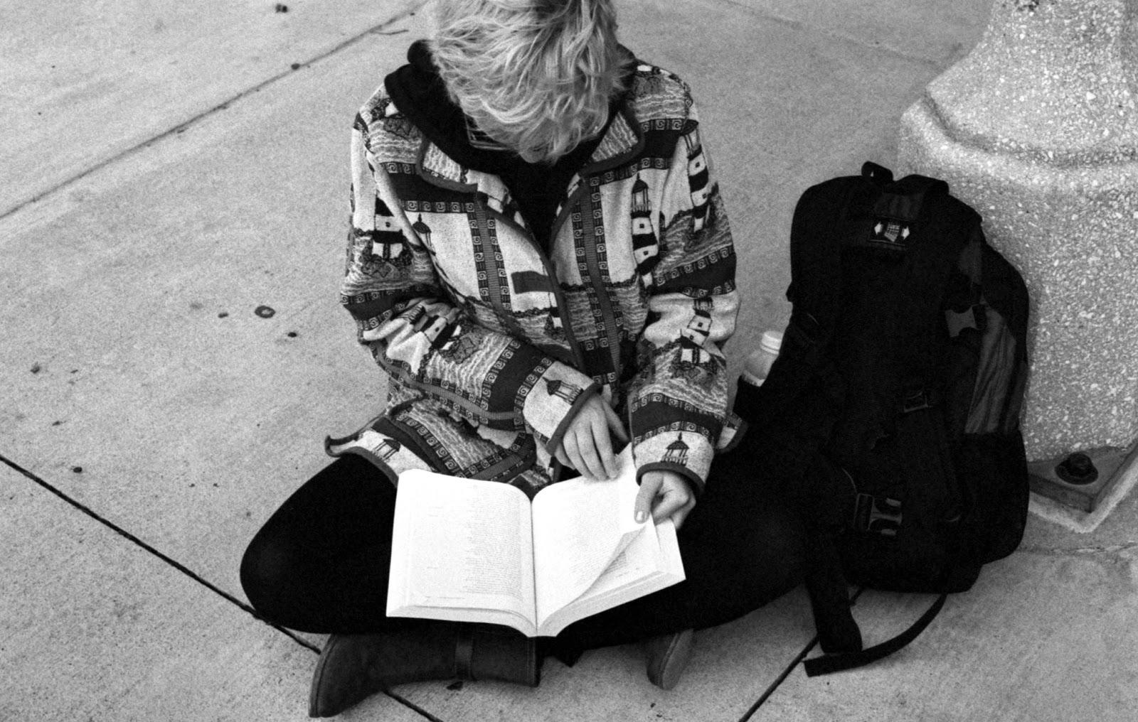 Girl reading on UT Austin Campus