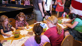 Kids doing crafts at Santa Land at Bass Pro Shops