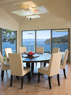 Appealing Blue Sea View near Dining Room with Round Dining Tables and Cozy Chairs on Hardwood Floor
