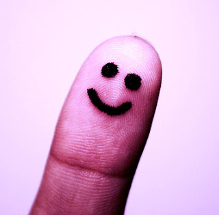 Smiling face drawn on a thumb