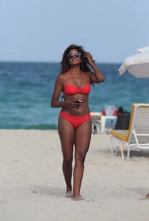 Claudia Jordan hot in  Red Bikini and black sunglasses