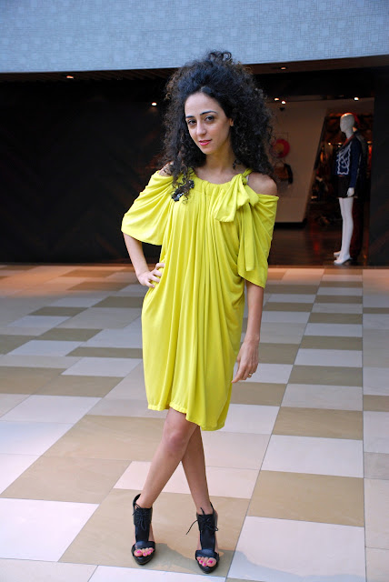 Rana Wehbe-Flinter wears a yellow dress from Hansel