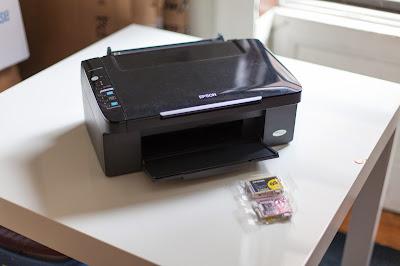 como restablecer las almohadillas de Epson Stylus NX100 / NX105