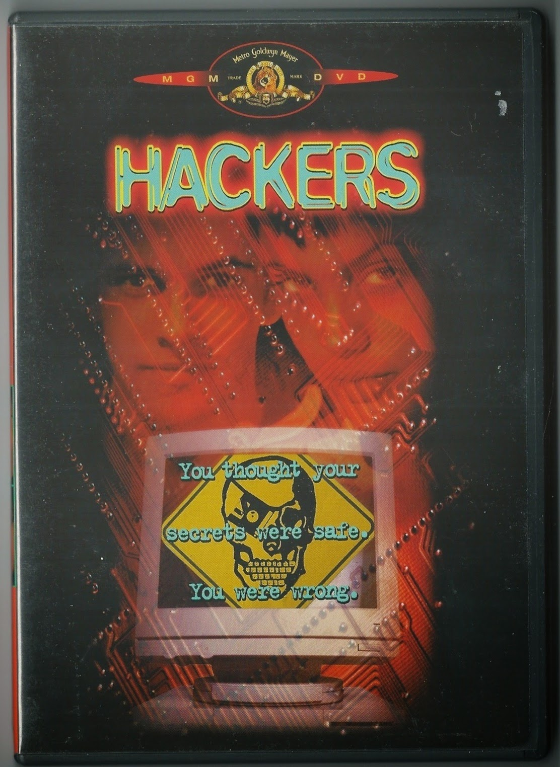 Box cover for DVD movie showing two teenagers above a computer screen with a scull