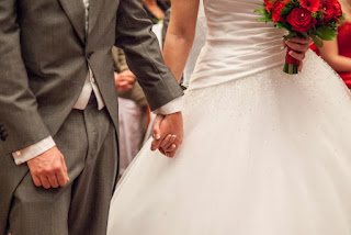 Couple holding hands by portrait wedding photographers