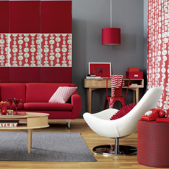 room with red headdress feature bring zest to an all white living room