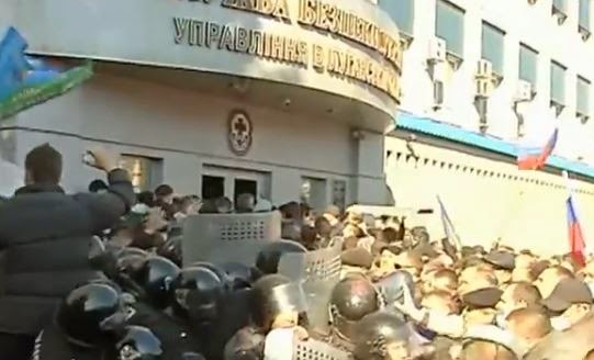 Pro-Russia protesters storm a government building in Lugansk, Ukraine. (Screen capture from YouTube Video)