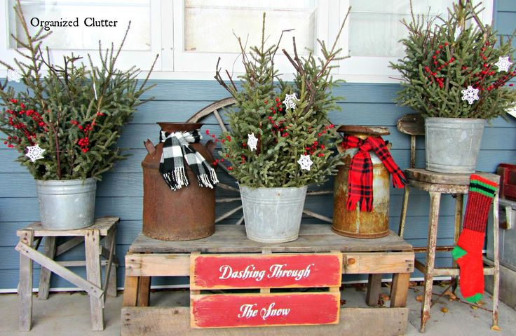 Rustic pots of spruce treetops, weathered wood and warm woolens www.organizedclutterqueen.blogspot.com