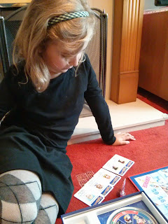 Top Ender studying her cards