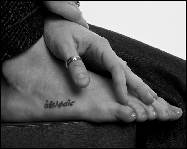 photo by Eugene Pierce of feet and hands with tattoo in black and white