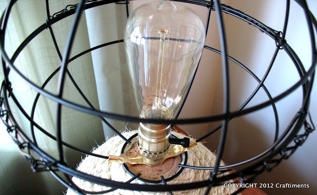 Craftiments.com:  Openwork globe shade made from two hanging planters