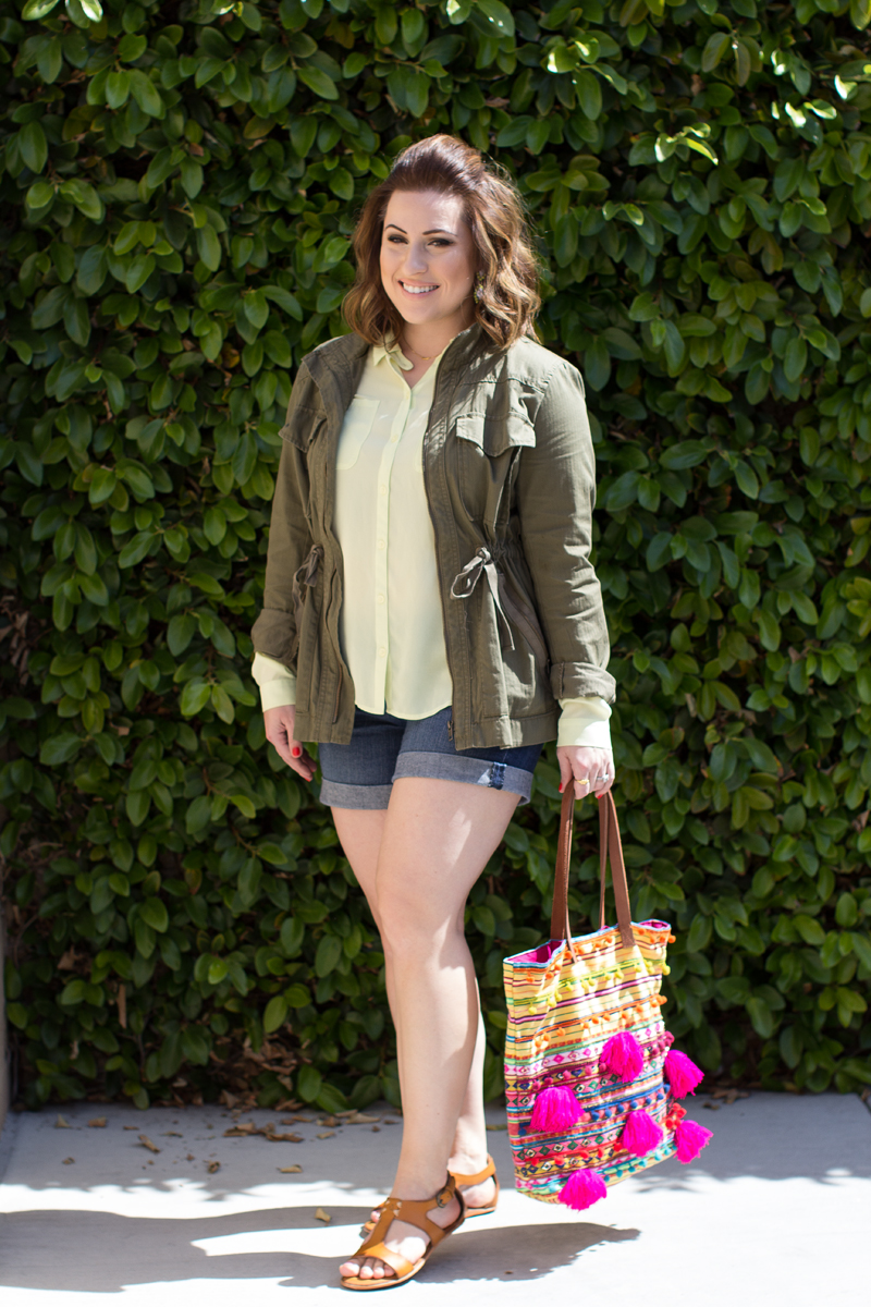 asos beaded pom pom tote, jcrew military jacket, loft neon shirt, loft denim shorts, olukai pouli sandals