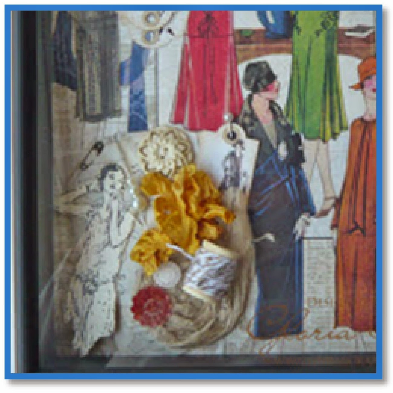 shadow box contents include sewing patterns