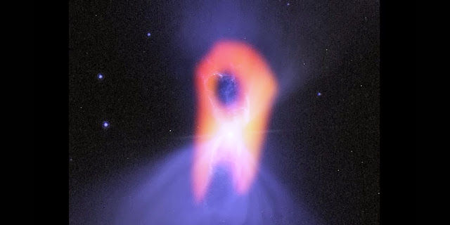 "The Boomerang Nebula, called the ""coldest place in the Universe,"" reveals its true shape with ALMA. The background blue structure, as seen in visible light with the Hubble Space Telescope, shows a classic double-lobe shape with a very narrow central region. ALMA's resolution and ability to see the cold molecular gas reveals the nebula's more elongated shape, as seen in red.  Credit: Bill Saxton; NRAO/AUI/NSF; NASA/Hubble; Raghvendra Sahai"
