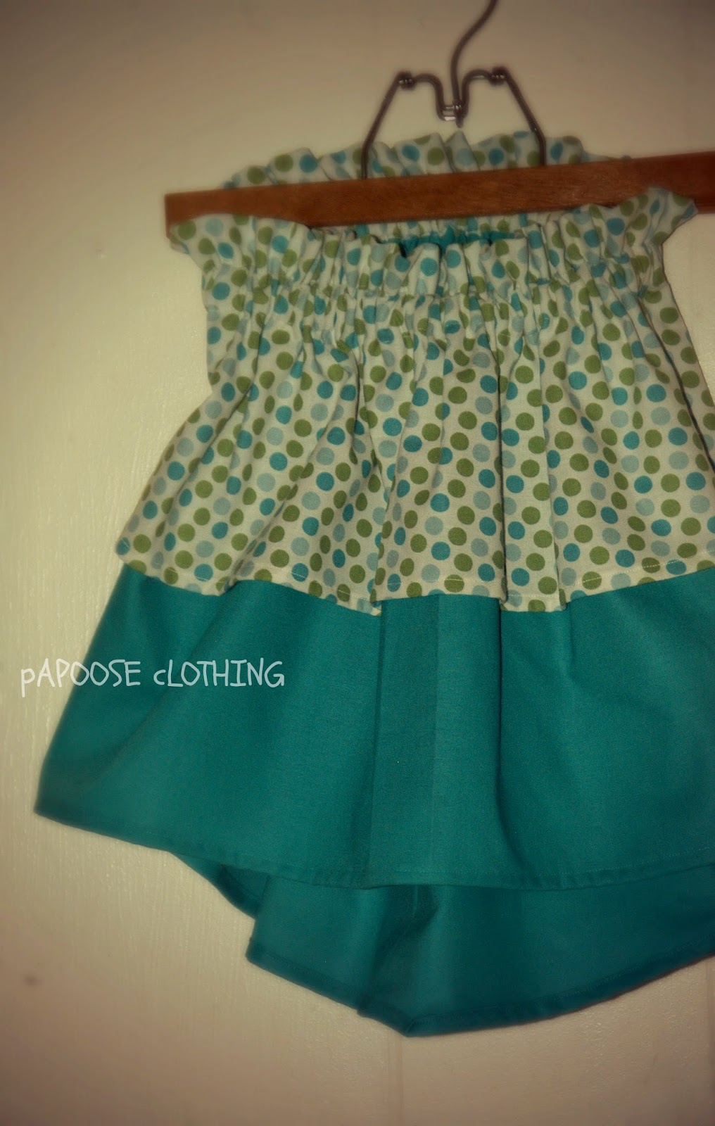 http://www.papooseclothing.com/store/p31/Shrimp_Po%27boy_Polka_Dot_Cascade_Ruffle_Top_Skirt.html