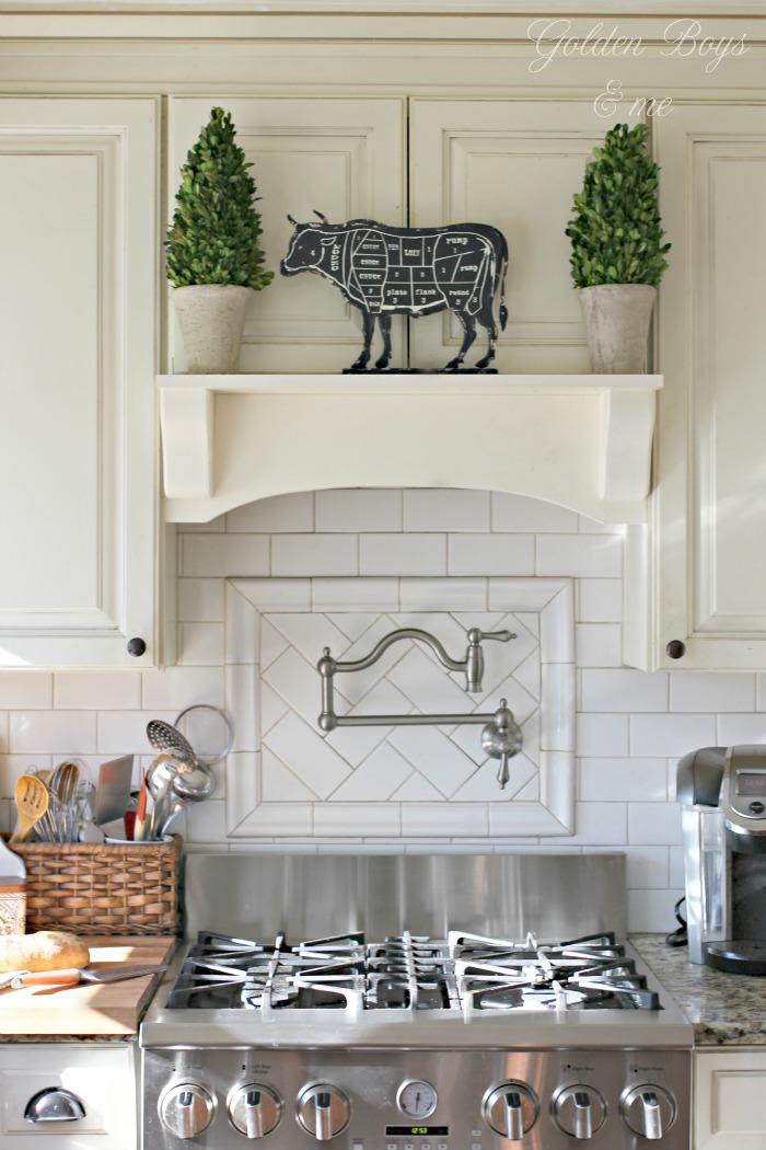 DIY mantel range hood with white subway tile and pot filler - www.goldenboysandme.com